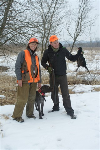 Hunters with pheasant